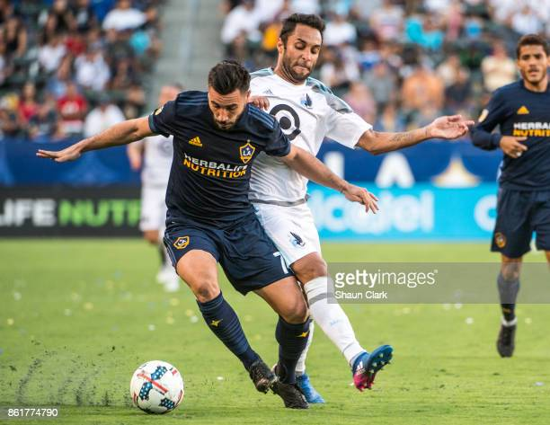 Romain Alessandrini of Los Angeles Galaxy battles Ibson of Minnesota United during the Los Angeles Galaxy's MLS match against Minnesota United at the...