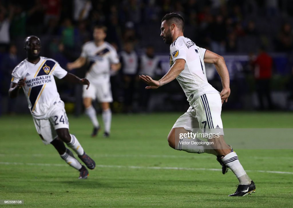Romain Alessandrini #7 of Los Angeles Galaxy celebrates after scoring a goal as teammate Ema Boateng #24 reacts during the second half of the MLS match against the San Jose Earthquakes at StubHub Center on May 25, 2018 in Carson, California. The Galaxy defeated the San Jose Earthquakes 1-0.
