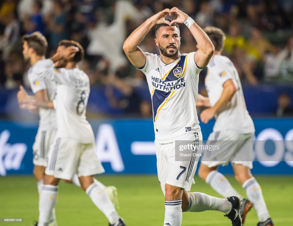Romain Alessandrini #7 of Los Angeles Galaxy celebrates his first goal during the Los Angeles Galaxy's MLS match against Columbus Crew at the StubHub Center on July 7, 2018 in Carson, California. Los Angeles Galaxy won the match 4-0