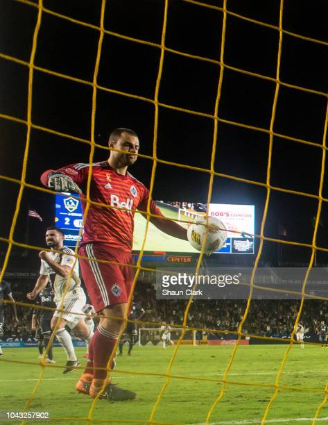 Romain Alessandrini of Los Angeles Galaxy celebrates his penalty kick goal as Stefan Marinovic of Vancouver Whitecaps retrieves the ball from the...
