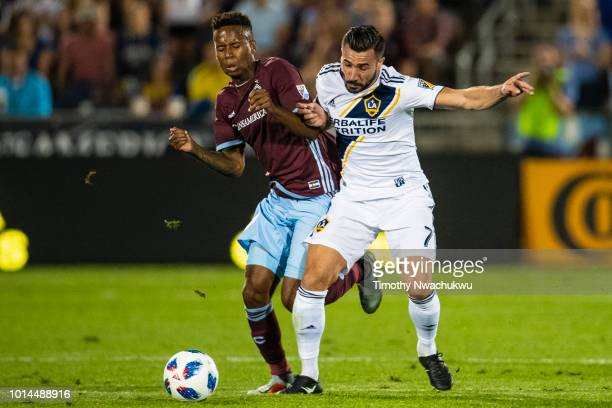 Romain Alessandrini of Los Angeles Galaxy collides with Kellyn Acosta of Colorado Rapids at Dick's Sporting Goods Park on August 4 2018 in Commerce...