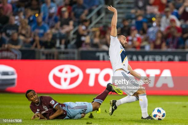 Romain Alessandrini of Los Angeles Galaxy dribbles past Marlon Hairston of Colorado Rapids at Dick's Sporting Goods Park on August 4 2018 in Commerce...