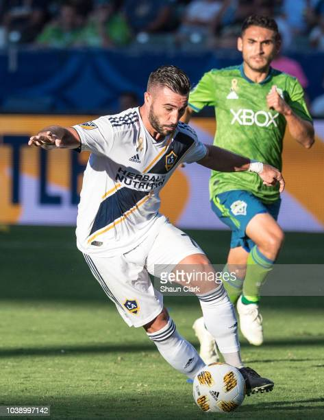 Zlatan Ibrahimovic of Los Angeles Galaxy is injured during the Los Angeles Galaxy's MLS match against Seattle Sounders at the StubHub Center on...