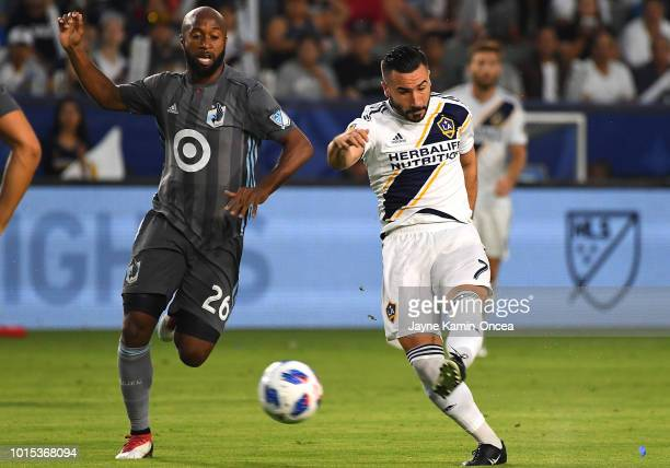 Romain Alessandrini of Los Angeles Galaxy kicks in a goal past Collen Warner of Minnesota United in the first half of the game at StubHub Center on...