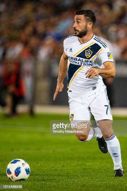 Romain Alessandrini of Los Angeles Galaxy looks for an open teammate at Dick's Sporting Goods Park on August 4 2018 in Commerce City Colorado