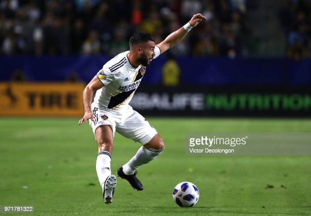 Romain Alessandrini of Los Angeles Galaxy paces the ball on the attack at midfield during first half of the MLS match against the FC Dallas at...