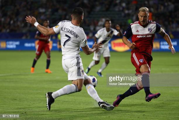 Romain Alessandrini of Los Angeles Galaxy plays the ball past Reto Ziegler of FC Dallas during the second half of the MLS match at StubHub Center on...