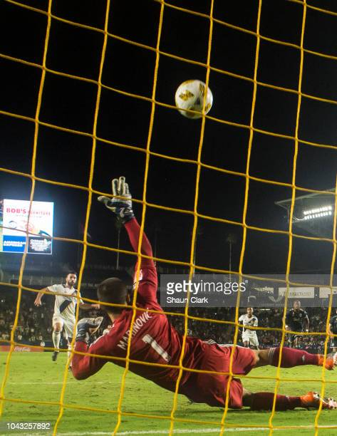 Romain Alessandrini of Los Angeles Galaxy scores a penalty kick goal as Stefan Marinovic of Vancouver Whitecaps tries to make a save during the Los...