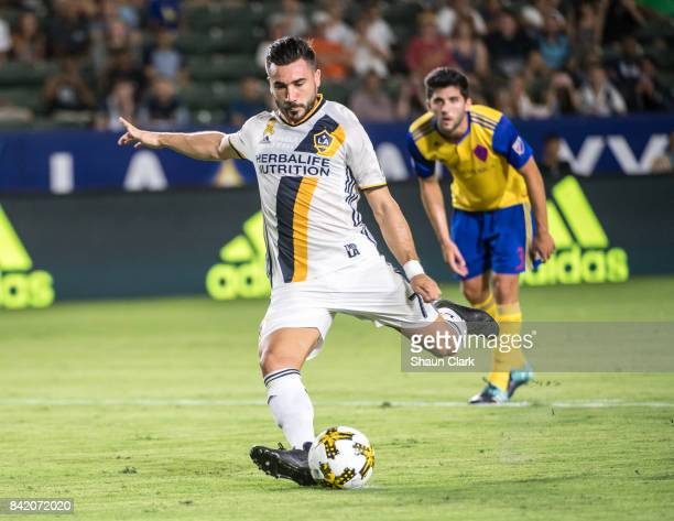 Romain Alessandrini of Los Angeles Galaxy scores a penalty kick during the Los Angeles Galaxy's MLS match against Colorado Rapids at the StubHub...