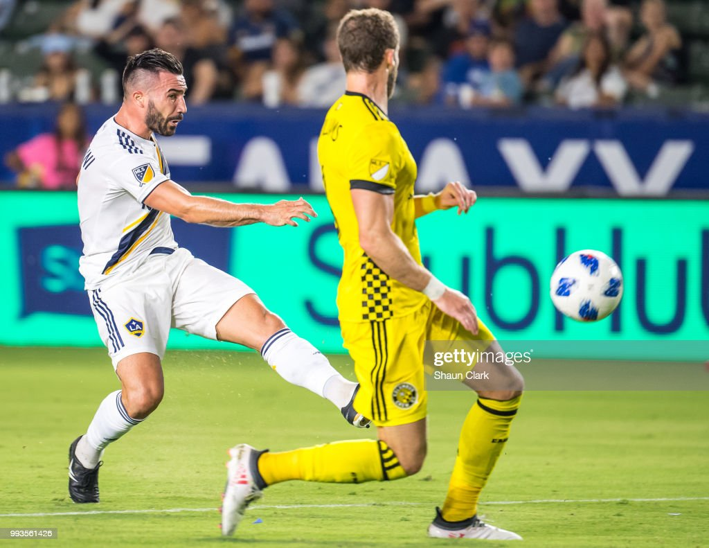 Romain Alessandrini #7 of Los Angeles Galaxy scores his second goal during the Los Angeles Galaxy's MLS match against Columbus Crew at the StubHub Center on July 7, 2018 in Carson, California. Los Angeles Galaxy won the match 4-0