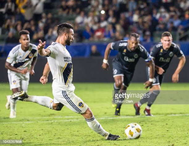 Romain Alessandrini of Los Angeles Galaxy scores on a penalty kick during the Los Angeles Galaxy's MLS match against Vancouver Whitecaps at the...
