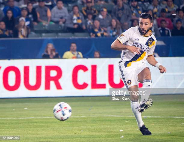 Romain Alessandrini of Los Angeles Galaxy takes a shot on goal during Los Angeles Galaxy's match against Philadelphia Union at the StubHub Center on...
