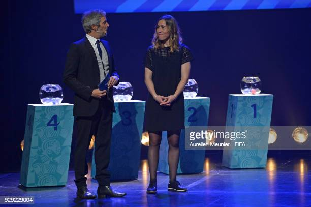 Romain Balland presents Camille Abily as he arrives for the official draw for the FIFA U20 Women's World Cup France 2018 on March 8 2018 in Rennes...