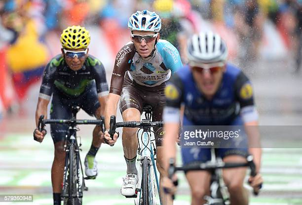 Romain Bardet of France and AG2R La Mondiale crosses the finish line between Dan Martin of Ireland and EtixxQuick Step and Nairo Quintana of Colombia...