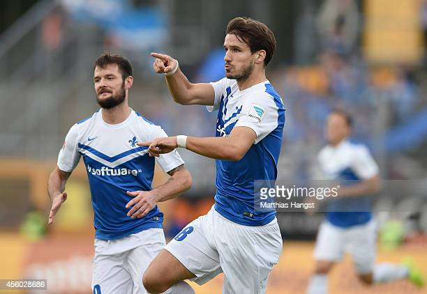 Romain Bregerie of Darmstadt celebrates with his team-mates after scoring his team's first goal during the Second Bundesliga match between SV...