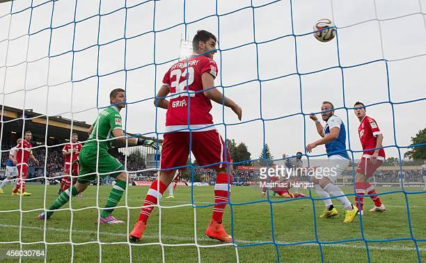 Romain Bregerie of Darmstadt scores his team's first goal past goalkeeper Patric Klandt of Frankfurt during the Second Bundesliga match between SV...