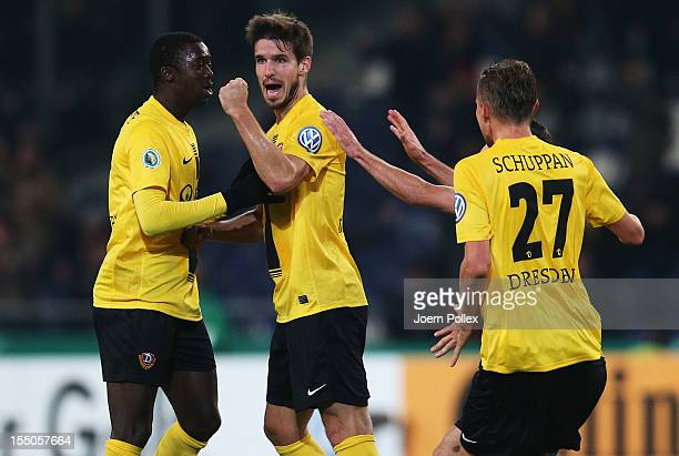 Romain Bregerie of Dresden celebrates with his team mates after scoring his team's first goal during the second round DFB Cup match between Hannover...