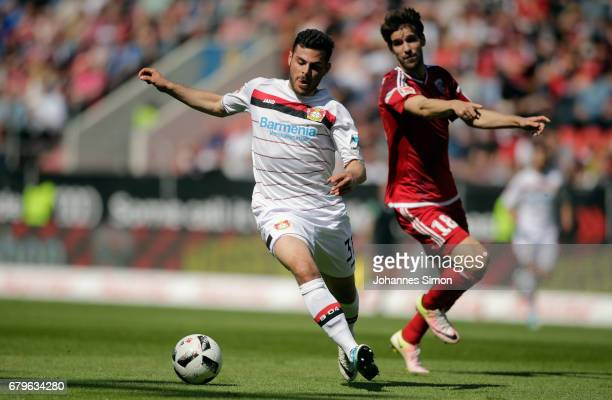 Romain Bregerie of Ingolstadt and Kevin Volland of Leverkusen fight for the ball during the Bundesliga match between FC Ingolstadt 04 and Bayer 04...