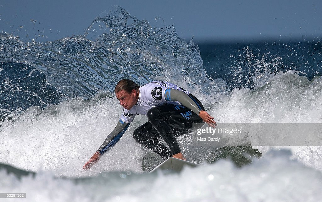 Romain Cloitre from Reunion competes in a heat of the UK Pro Surf Association's Men's Open on Fistral Beach on the second day of the Boardmasters surf and music festival in Newquay on August 7, 2014 in Cornwall, England. Since 1981, Newquay has been playing host to the Boardmasters surfing competition - which is part of a larger five-day surf, skate and music festival and has become a integral part of the continually popular British surf scene growing from humble beginnings, to one of the biggest events on the British surfing calendar. It now attracts professional surfers from across the globe to compete on the Cornish beach that is seen by many as the birthplace of modern British surfing.