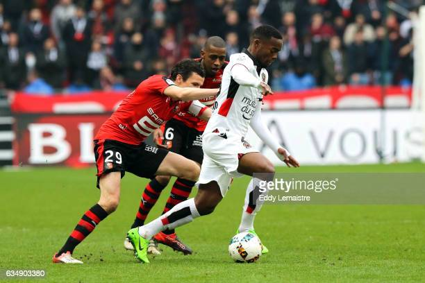 Romain Danze of Rennes and Wylan Cyprien of Nice during the Ligue 1 match between Stade Rennais and OGC Nice at Roazhon Park on February 12 2017 in...