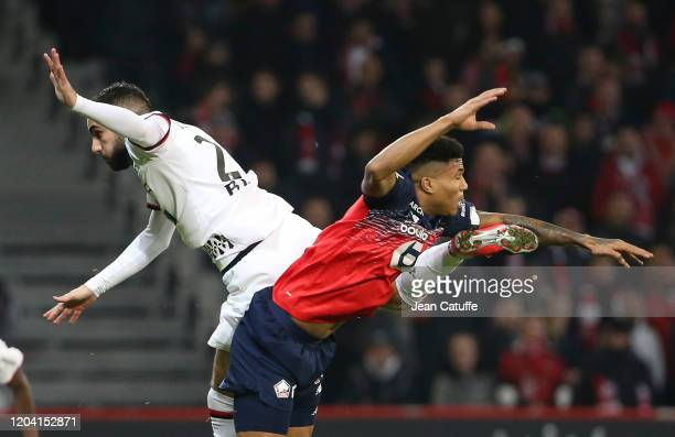 Romain Del Castillo of Stade Rennais, Reinildo Mandava of Lille during the Ligue 1 match between Lille OSC and Stade Rennais at Stade Pierre Mauroy...