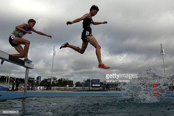 Romain Donneux of Melbourne Uni and Brandon Nairn of New South Wales compete in the Men's 3000 metre steeplechase open during Zatopek10 held at...