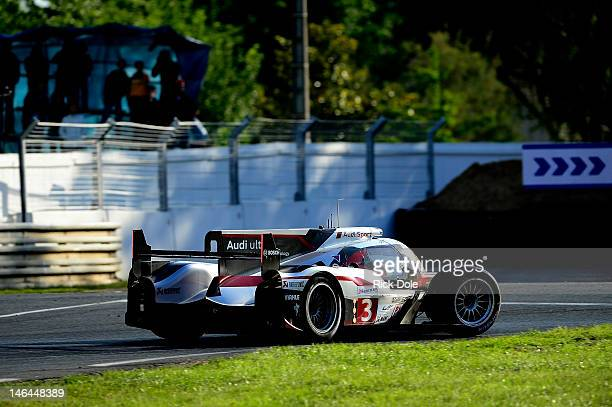 Romain Dumas of France drives the Audi R18 ultra back to the pits after a crash during the 80th running of the Le Mans 24 Hour race at the Circuit...