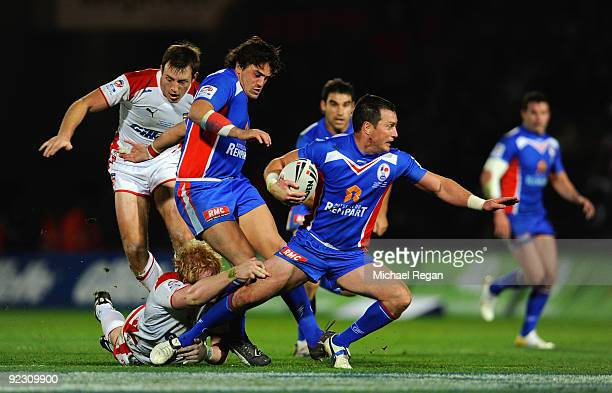Romain Gagliazzo and James Wynn keep possession for France dispite of pressure from James Roby and James Graham of England during the Gillette Four...