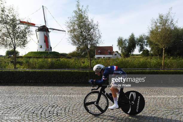Romain Gregoire of France sprints in front of a windmill in Damar City during the 94th UCI Road World Championships 2021 - Men Junior ITT a 22,3km...