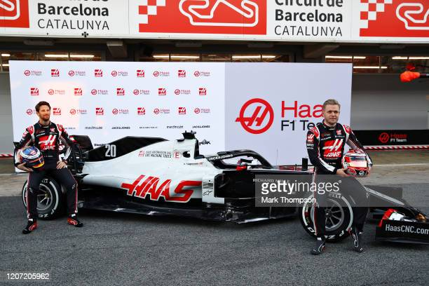 Romain Grosjean of France and Haas F1 and Kevin Magnussen of Denmark and Haas F1 are pictured at the roll out of the Haas F1 Team VF20 Ferrari during...