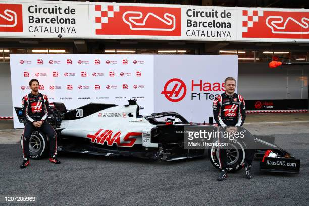 Romain Grosjean of France and Haas F1 and Kevin Magnussen of Denmark and Haas F1 are pictured at the roll out of the Haas F1 Team VF-20 Ferrari...
