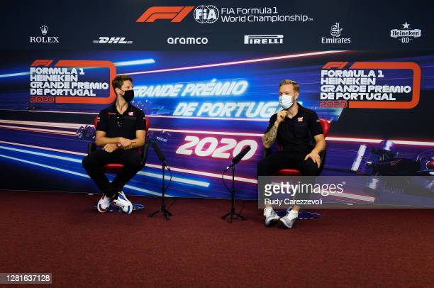 Romain Grosjean of France and Haas F1 and Kevin Magnussen of Denmark and Haas F1 talk in the Drivers Press Conference during previews ahead of the F1...