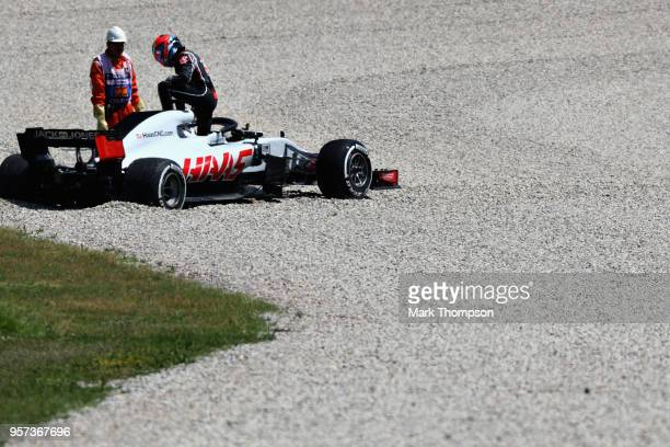 Romain Grosjean of France and Haas F1 climbs from his car after stopping on track during practice for the Spanish Formula One Grand Prix at Circuit...
