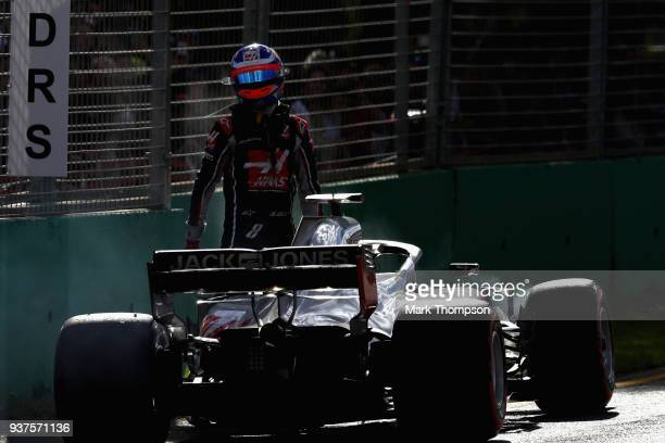 Romain Grosjean of France and Haas F1 climbs from his car after retiring during the Australian Formula One Grand Prix at Albert Park on March 25,...