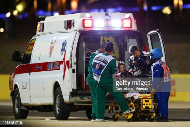 Romain Grosjean of France and Haas F1 is pictured being helped into an ambulance after a crash during the F1 Grand Prix of Bahrain at Bahrain...