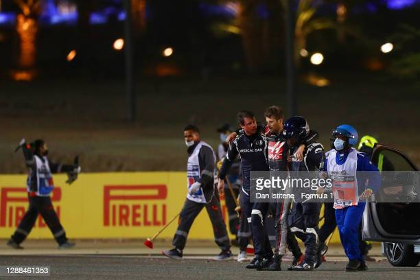 Romain Grosjean of France and Haas F1 is pictured walking from his car after a crash during the F1 Grand Prix of Bahrain at Bahrain International...