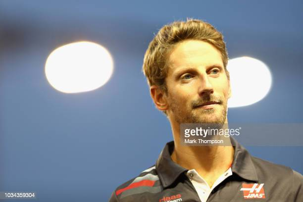 Romain Grosjean of France and Haas F1 looks on before the Formula One Grand Prix of Singapore at Marina Bay Street Circuit on September 16 2018 in...