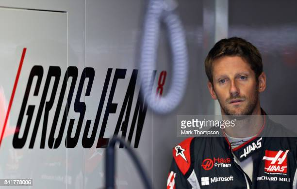 Romain Grosjean of France and Haas F1 looks on in the garage during a rain delayed final practice for the Formula One Grand Prix of Italy at...