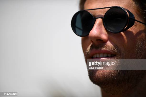 Romain Grosjean of France and Haas F1 looks on in the Paddock during previews ahead of the F1 Grand Prix of Azerbaijan at Baku City Circuit on April...