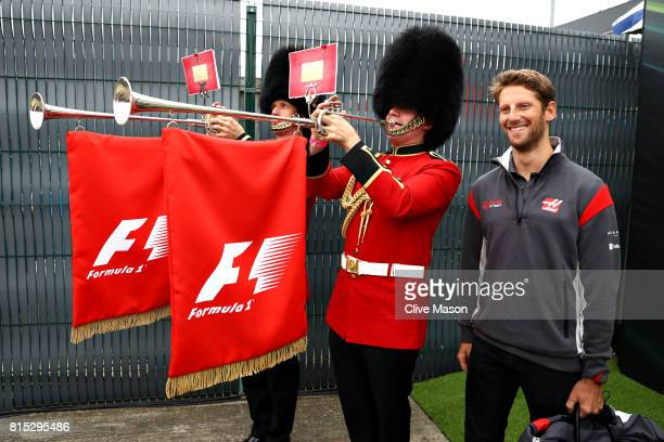 Romain Grosjean of France and Haas F1 poses for a photo with Queens Guards wearing traditional bearskin hats before the Formula One Grand Prix of...