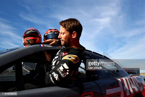 Romain Grosjean of France and Haas F1 prepares to drive the No.14 Haas Automation Ford Mustang in a demonstration run during previews ahead of the F1...