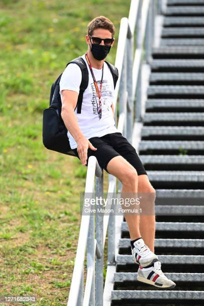 Romain Grosjean of France and Haas F1 slides down a bannister during previews ahead of the F1 Grand Prix of Tuscany at Mugello Circuit on September...