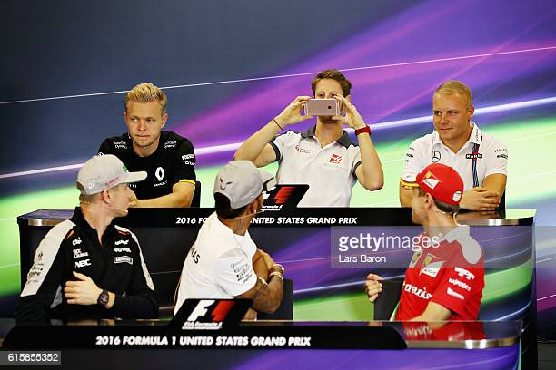 Romain Grosjean of France and Haas F1 takes a photo of Lewis Hamilton of Great Britain and Mercedes GP Sebastian Vettel of Germany and Ferrari and...