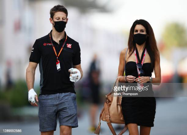 Romain Grosjean of France and Haas F1 walks in the Paddock with his wife Marion before final practice ahead of the F1 Grand Prix of Sakhir at Bahrain...