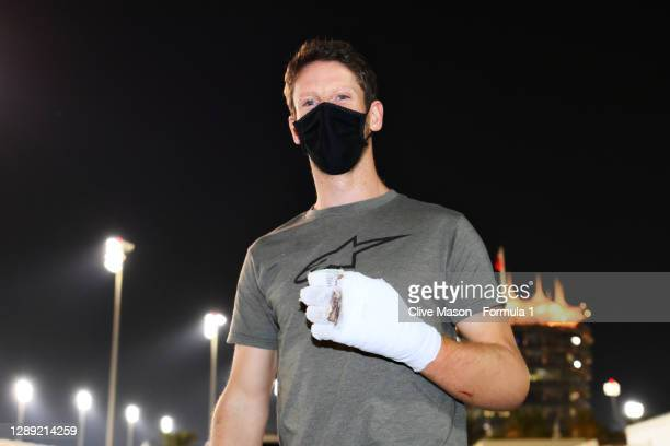 Romain Grosjean of France and Haas F1 walks in the Paddock with bandages on his burnt hands after his crash at the previous race during previews...