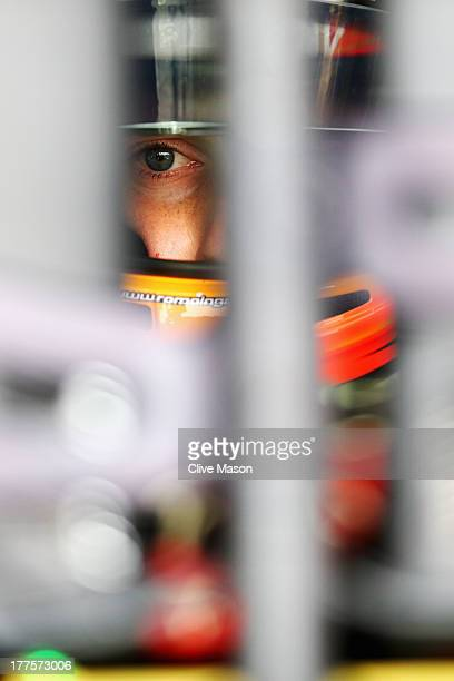 Romain Grosjean of France and Lotus prepares to drive in the final practice session prior to qualifying for the Belgian Grand Prix at Circuit de...