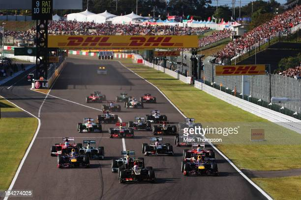 Romain Grosjean of France and Lotus takes the lead at the start of the Japanese Formula One Grand Prix at Suzuka Circuit on October 13 2013 in Suzuka...