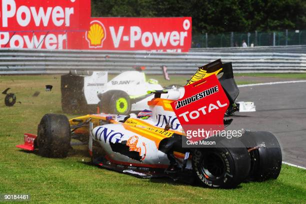 Romain Grosjean of France and Renault and Jenson Button of Great Britain and Brawn GP collide at Les Combes corner on the first lap of the Belgian...