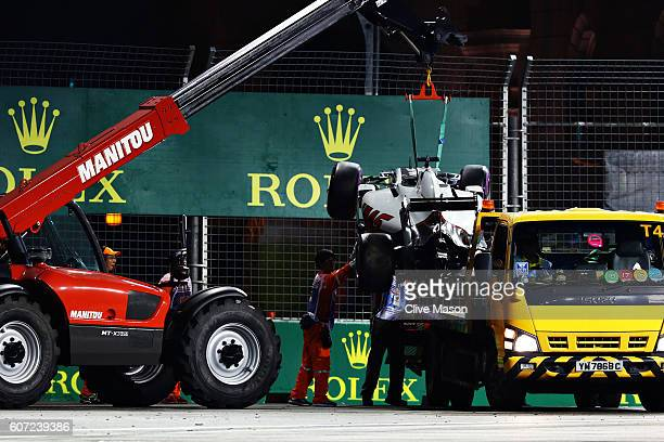 Romain Grosjean of France driving the Haas F1 Team HaasFerrari VF16 Ferrari 059/5 turbo is removed from the circuit during qualifying for the Formula...