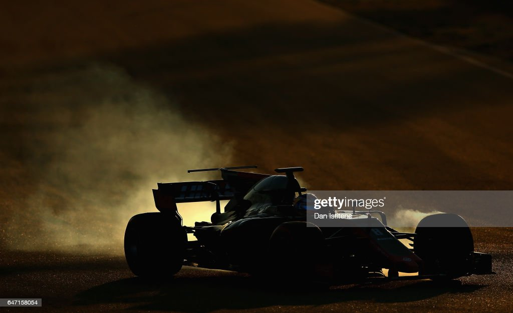Romain Grosjean of France driving the (8) Haas F1 Team Haas-Ferrari VF-17 Ferrari locks a wheel under braking on track during day four of Formula One winter testing at Circuit de Catalunya on March 2, 2017 in Montmelo, Spain.